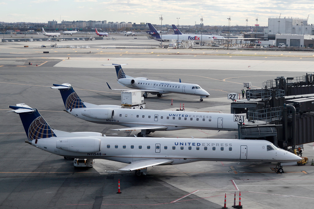 . United Airlines planes appear on the tarmac at Newark Liberty International Airport, Tuesday, Nov. 22, 2016, in Newark, N.J. Almost 49 million people are expected to travel 50 miles or more for the holiday, the most since 2007, according to AAA. Most of them will drive, helped by relatively low gas prices and an improving economy. (AP Photo/Julio Cortez)