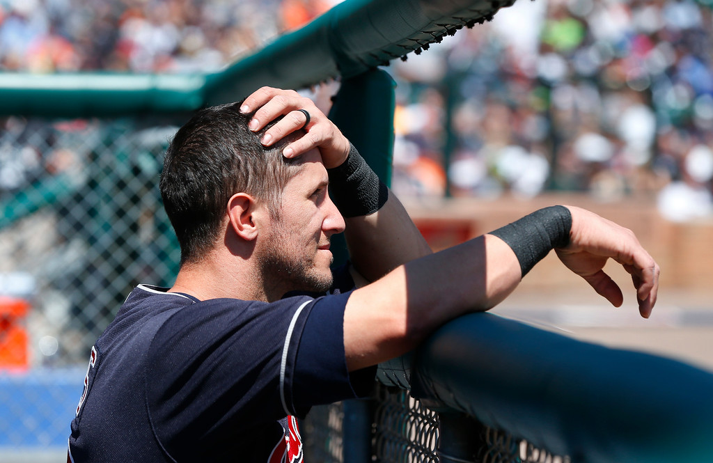 . Cleveland Indians\' Yan Gomes reacts to pitcher Carlos Carrasco being helped off the field in the third inning of a baseball game against the Detroit Tigers, Sunday, April 24, 2016, in Detroit. (AP Photo/Paul Sancya)