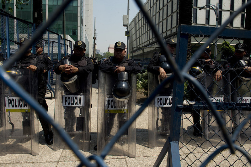. Riot Police officers stand guard outside the US embassy in Mexico City as people demonstrate during a protest organized by the Meso-American Migrant Movement to demand the deportation of Mexicans from the US to stop, on May 2, 2013. Migration will be among the top issues when US President Barack Obama visits Mexico and Costa Rica this week, and many in the region hope Washington will finally act to give 11 million undocumented workers a path to citizenship. Obama headed to Mexico on Thursday to put trade back at the heart of bilateral ties, but his southern neighbour\'s shifting drug war tactics loom large over the visit.   YURI CORTEZ/AFP/Getty Images
