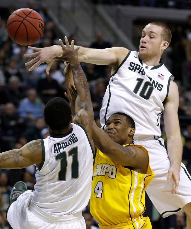 . Valparaiso guard LaVonte Dority (4) is defended by Michigan State guard Keith Appling (11) and Matt Costello (10) in the first half of a second-round game of the NCAA college basketball tournament in Auburn Hills, Mich., Thursday March 21, 2013. (AP Photo/Paul Sancya)