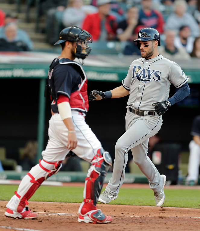 . Tampa Bay Rays\' Kevin Kiermaier scores on Brad Miller\'s RBI-single in the fourth inning of a baseball game aCleveland Indians, Monday, May 15, 2017, in Cleveland. Cleveland Indians catcher Yan Gomes watches. (AP Photo/Tony Dejak)