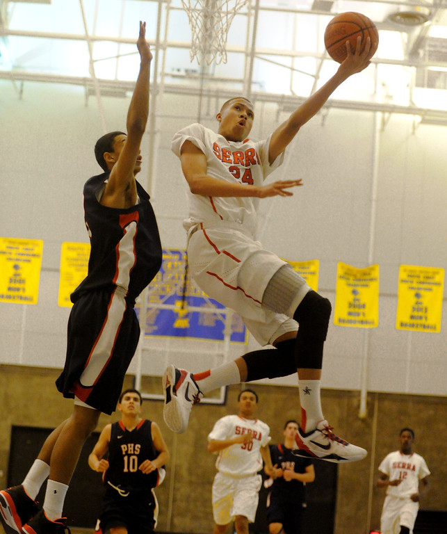 . 03-12-2013--(LANG Staff Photo by Sean Hiller)-Serra\'s Ron Freeman sail for two points against Pacific Hills\' Marcus Jackson in Tuesday\'s boys basketball IV Southern California Regional semifinal at L.A. Southwest College.