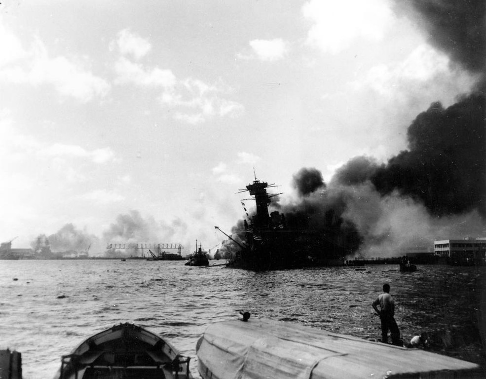 . The battleship USS California is afire and listing to port in the Japanese aerial attack on Pearl Harbor, Hawaii, on Dec. 7, 1941.  Durrell Conner, who coded and decoded messages for the Navy, was aboard the USS California when it sank in Pearl Harbor on Dec. 7, 1941.  Conner will return with 17 family members to remember those who died in the Japanese attack 69 years ago during the Pearl Harbor Anniversary.  (AP Photo)