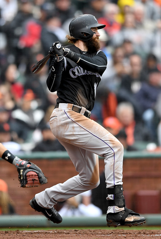 . SAN FRANCISCO, CA - MAY 07:  Charlie Blackmon #19 of the Colorado Rockies hits a double against the San Francisco Giants in the top of the six inning at AT&T Park on May 7, 2016 in San Francisco, California.  (Photo by Thearon W. Henderson/Getty Images)