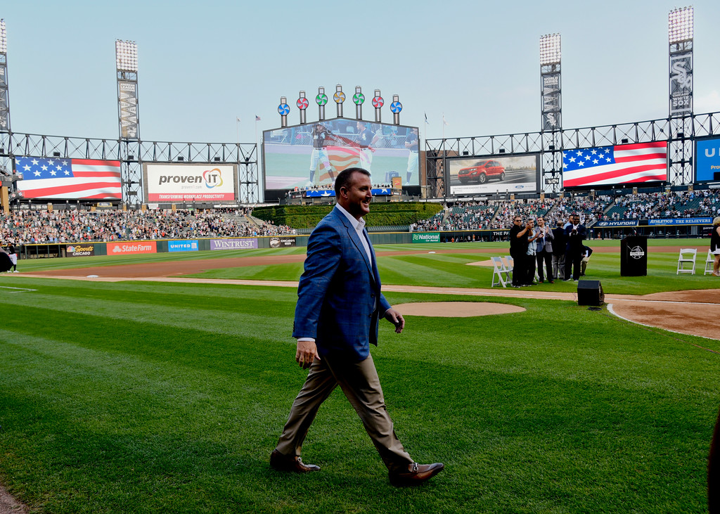. Chicago White Sox great Jim Thome, a recent inductee at the Baseball Hall of Fame, walks onto the field before the team\'s baseball game against the Cleveland Indians on Saturday, Aug. 11, 2018, in Chicago. (AP Photo/Matt Marton)