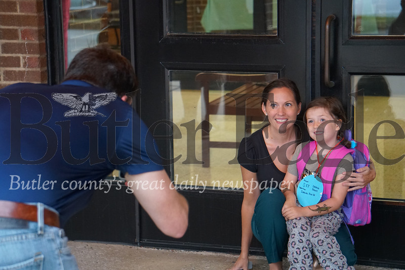 Photo by J.W. Johnson Jr. Jessica Schmitt poses for a photo with her daughter, Olive, taken by Thomas Schmitt on the first day of school Tuesday at Haine Elementary School.