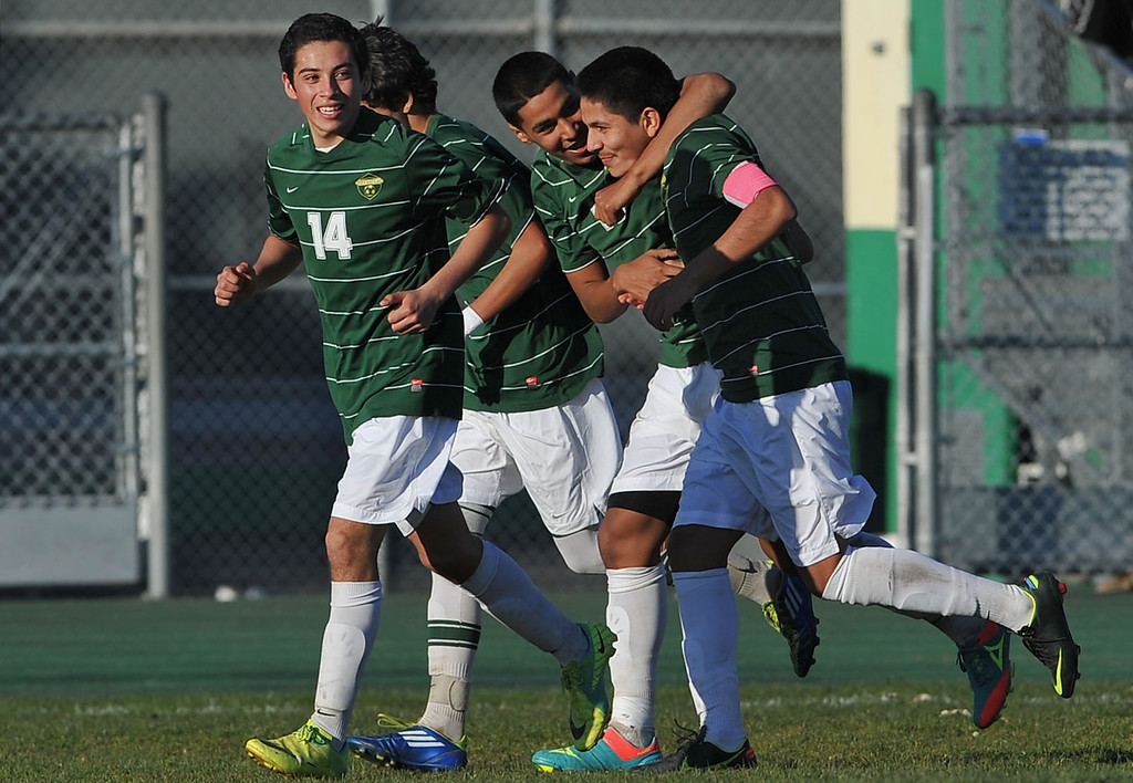 . 2/13/13 - Alfonso Moreno of Narbonne is congratulated after scoring during the L.A. City Section Division I playoffs. Narbonne won 1-0. Photo by Brittany Murray / Staff Photographer