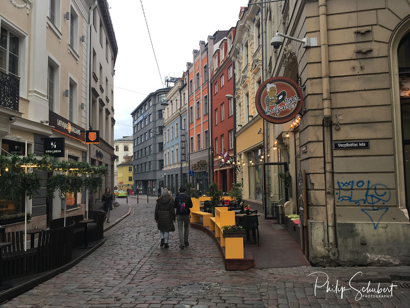 Riga,Latvia - May 14, 2019: Street scenes of Old Town Riga on a cloudy spring Day. The city has many delighfully restored buildings.