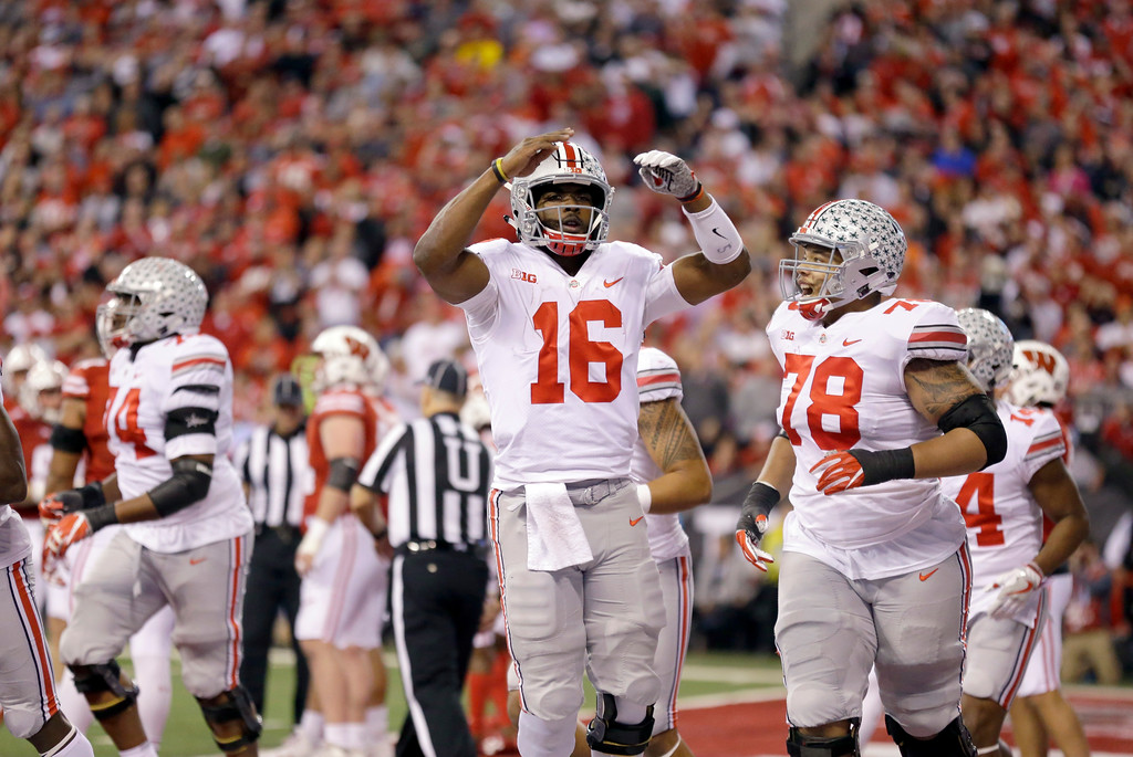 . Ohio State quarterback J.T. Barrett (16) and offensive lineman Demetrius Knox celebrate during the first half of the Big Ten championship NCAA college football game against Wisconsin, Saturday, Dec. 2, 2017, in Indianapolis. (AP Photo/Michael Conroy)