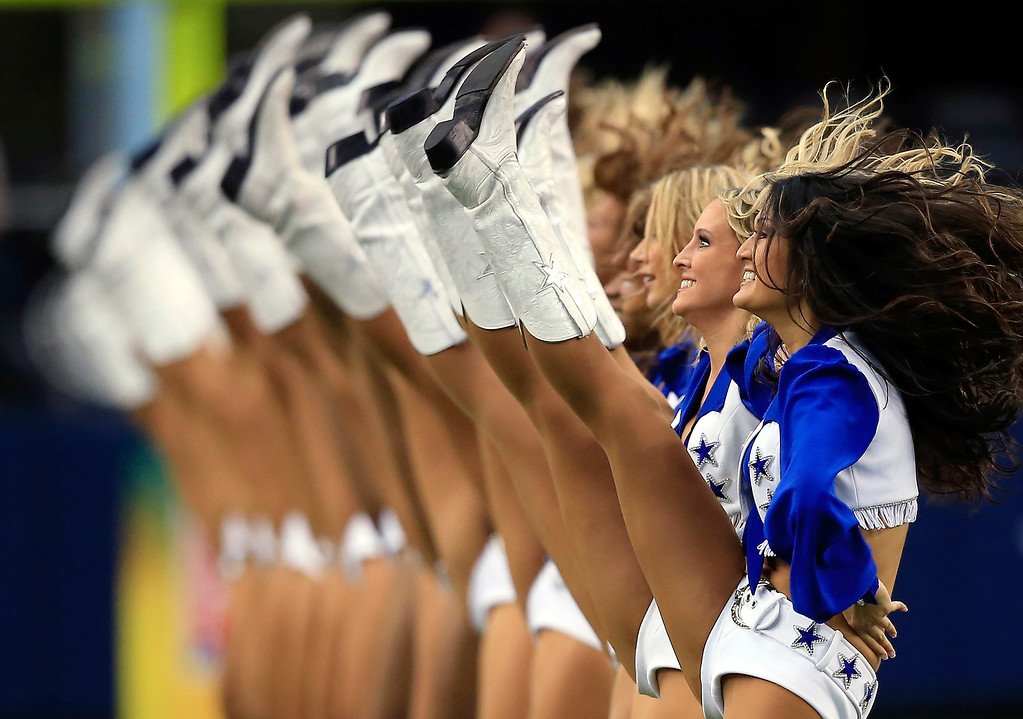 . The Dallas Cowboys cheerleaders perform during the game against the St. Louis Rams at AT&T Stadium on September 22, 2013 in Arlington, Texas.  (Photo by Jamie Squire/Getty Images)