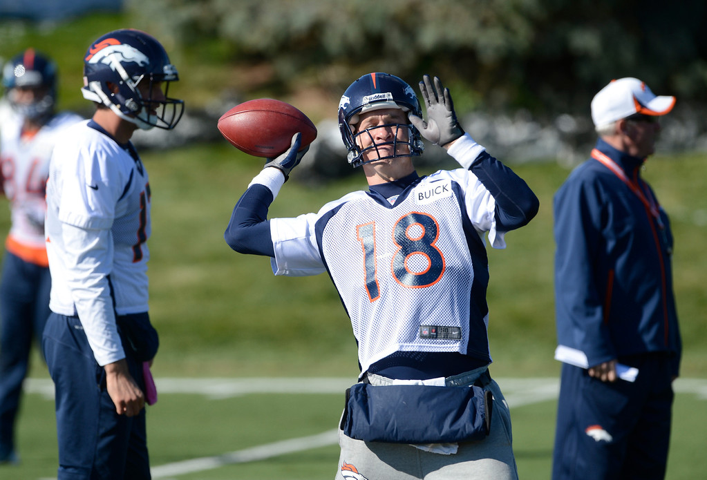. Denver Broncos QB, Peyton Manning, throws during practice Friday morning, October 18, 2103.  (Photo By Andy Cross/The Denver Post)