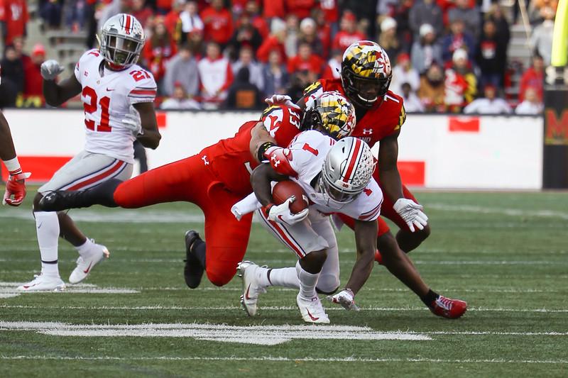 Maryland LB #33 Tre Watson tackles Ohio State WR #1 Johnnie Dixon III