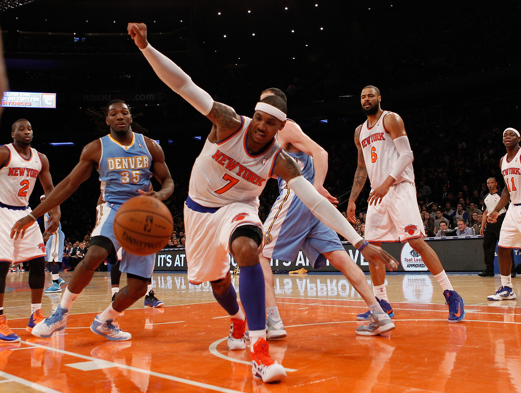 . Carmelo Anthony #7 of the New York Knicks pursues a ball as it goes out of bounds in the game against the Denver Nuggets at Madison Square Garden on December 9, 2012 in New York City.  (Photo by Bruce Bennett/Getty Images)