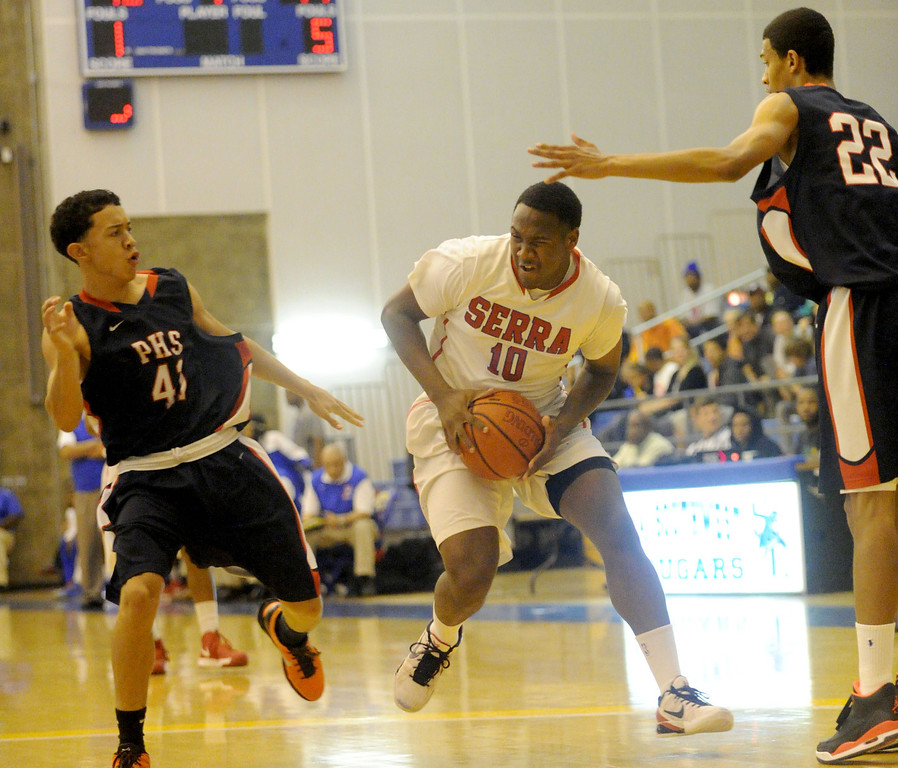 . 03-12-2013--(LANG Staff Photo by Sean Hiller)-Serra\'s Jason Richardson battles Pacific Hills\' Devin Wikkramatillake, left, Marcus Jackson in Tuesday\'s boys basketball IV Southern California Regional semifinal at L.A. Southwest College.