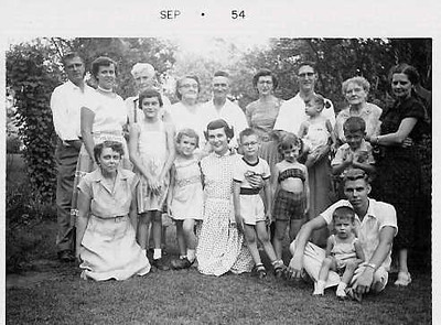 Grandmother Skinner (Pratt) side: -to-r in front: Marg Skinner, Janet Hatchard, Marnie, Dobbie, Steve Colton, Laura colton, Bob Skinner and in his lap was Drew Porter, Aunt Florence's younger son. Back row l-to-r: Bill Skinner (Marg's husb), Ellen Skinner, Great-Grandpa Pratt (Dobbie's maternal grandfather), Myrtle and Luman Colton (Dobbie's parents), Ahlene Colton and Luman Colton (holding Susie), Gram Pratt (Dobbie's maternal grandma), Johnny Porter (in front of Gram), and Florence Porter. My grandma Colton (Myrtle) was the oldest of the Pratt sisters, then Marg, and Florence was the youngest.   Grandma Pratt was Florence Hoinville.  The Hoinvilles were French and immigrated to England, maybe in the 1600 or 1700s.  Grandma's dad was William Hoinville who immigrated from London to Chicago.  Margaret Corcoran, from County Cork in Ireland, immigrated to Chicago in the late 1800s and met William there, where they married.
