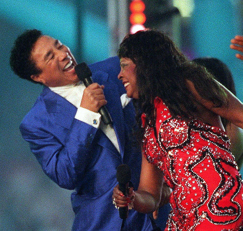 . Motown legends Smokey Robinson (L) and Martha Reeves (R) perform during halftime at Super Bowl XXXII at Qualcomm Stadium at San Diego, CA 25 January. The halftime show celebrated the 40th anniversary of Motown Records.  (DOUG COLLIER/AFP/Getty Images)