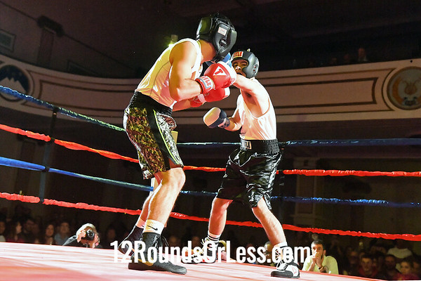 Bout 7:   Chuckie Bizzarro, Red Gloves, Erie BC, Erie, PA   -vs-   Marcello Senegal, Blue Gloves, United BC, Lorain, OH   166 Lbs., Sub-Novice