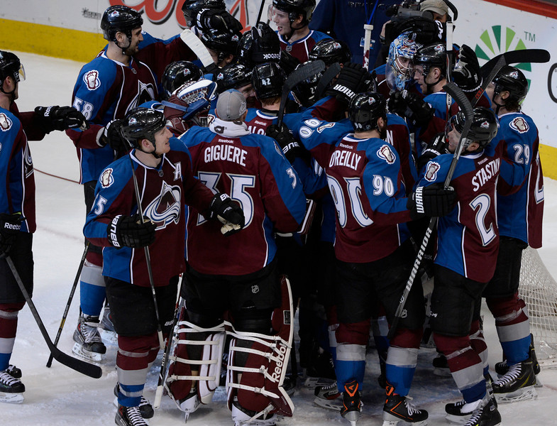 . Colorado Avalanche teammates swarm goalie, Semyon Varlamov, upper right corner, celebrating their  victory over the San Jose Sharks at the Pepsi Center Saturday afternoon, March 29, 2014. The Av\'s won 3-2 securing a playoff spot with the win. (Photo By Andy Cross / The Denver Post)