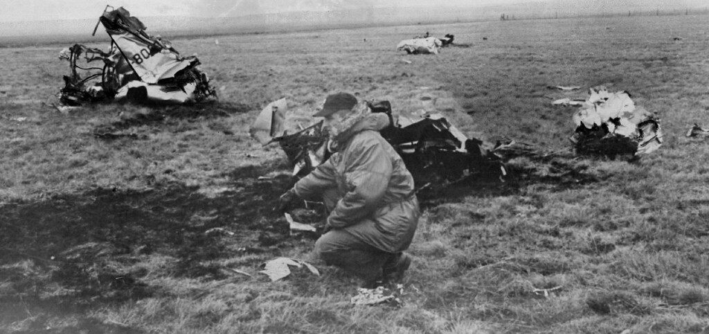 . Captain Bob Groom, 4600th Air Base Wing Information Officer inspects a crash site. Two Air Force Academy officers lost their lives when T-33 jet trainer crashed during landing at Peterson Field. 1969. The Denver Post Library Archive
