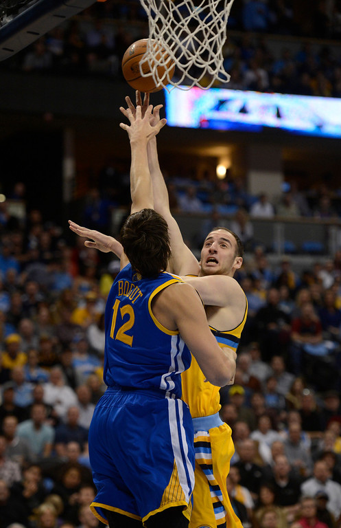 . DENVER, CO. - APRIL 23: Denver Nuggets center Kosta Koufos (41) puts up a shot over Golden State Warriors center Andrew Bogut (12) in the first quarter. The Denver Nuggets took on the Golden State Warriors in Game 2 of the Western Conference First Round Series at the Pepsi Center in Denver, Colo. on April 23, 2013. (Photo by John Leyba/The Denver Post)