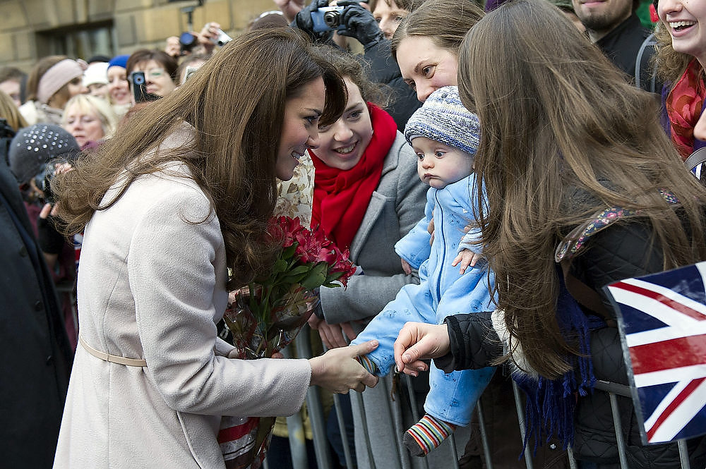 Description of . Catherine, Duchess of Cambridge meets 5 month-old James William Davies, who was named after Prince William, and his mother Tessa Davies in the Market Square during an official visit to the Guildhall on November 28, 2012 in Cambridge, England. (Photo by Arthur Edwards - Getty Images)