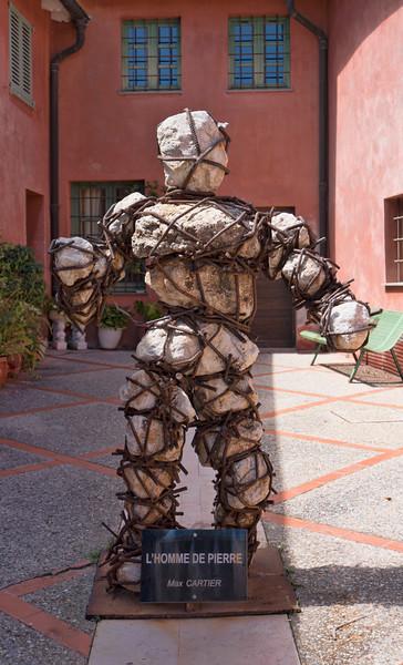 L'homme de Pierre Stone and Rebar Sculpture