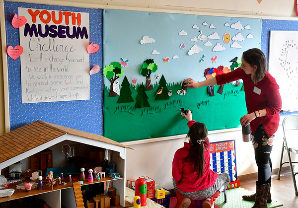 2/8/2020 Mike Orazzi   Staff New Britain Youth Museum's Liz Watt (right) works with Julia Parciak,9, during a Valentine's Day Party on Saturday.