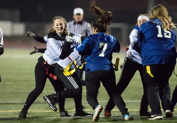 11/20/18 Wesley Bunnell | Staff Plainville Seniors vs Juniors in powder puff football on Tuesday night at Plainville High School. Junior Maggie Cronhkite (25) blocking.