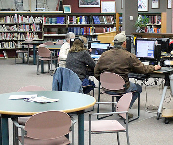 Even on the slowest of days, the computer area of the Grace Balloch Memorial Library continues to hum with activity.