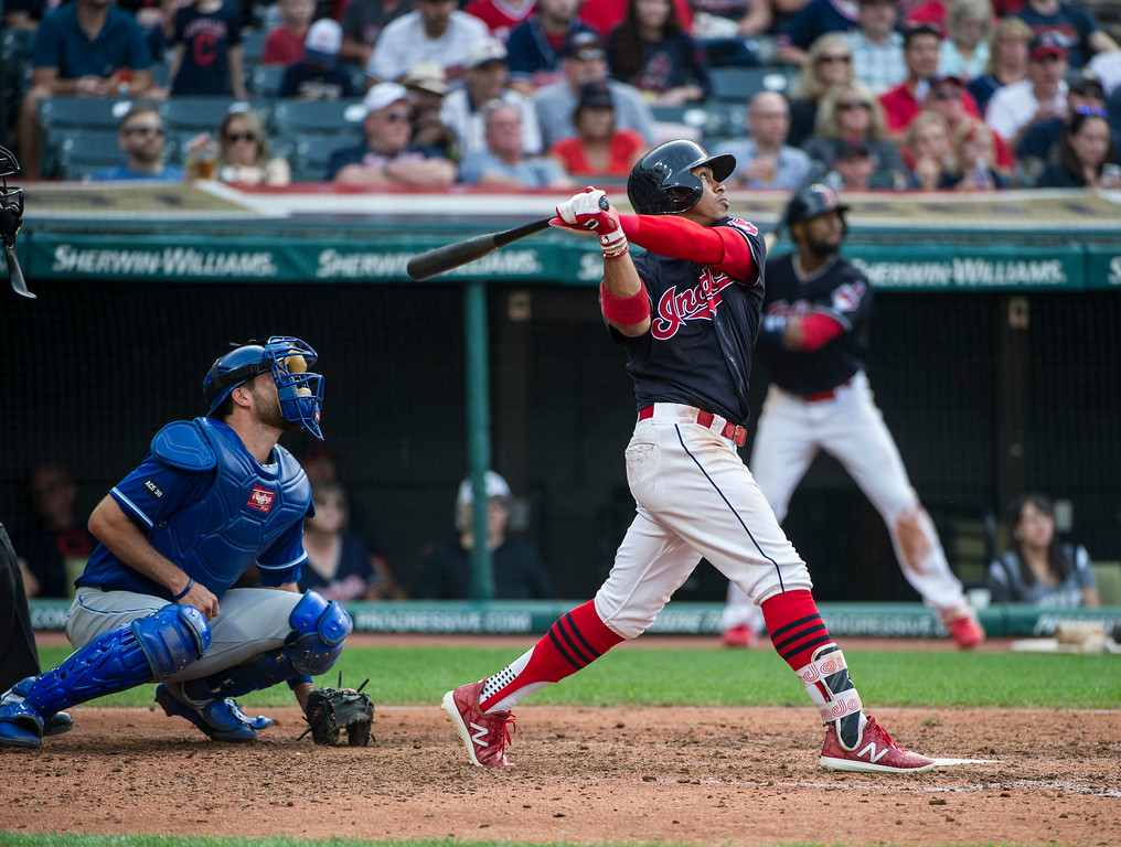 . Cleveland Indians\' Francisco Lindor and Kansas City Royals\' Drew Butera watch his two-run double during the sixth inning of a baseball game in Cleveland, Saturday, Sept. 16, 2017. (AP Photo/Phil Long)