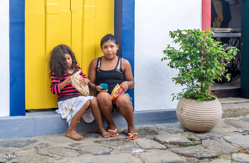 Girls in the doorway, Parati, Brazil