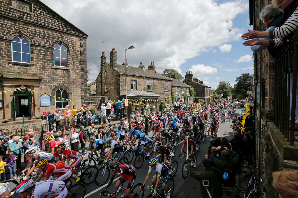 . Spectators watch the pack pass during the first stage of the Tour de France cycling race over 190.5 kilometers (118.4 miles) with start in Leeds and finish in Harrogate, England, Saturday, July 5, 2014. (AP Photo/Christophe Ena)