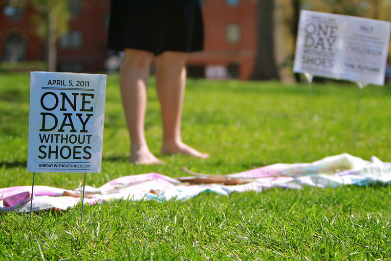 The students raise awareness by participating in One Day Without Shoes by going barefoot for the day and by donating new or gently worn shoes.