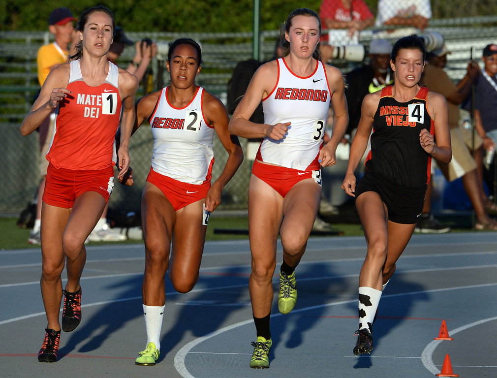 . Mater Dei\'s Ashlyn Rambo, left, Redondo Union\'s Amber Gore (2) and Anevay Hiehle along with Mission Viejo\'s Taylor Arco competes in the 800 meter run during the CIF-SS Masters Track and Field meet at Falcon Field on the campus of Cerritos College in Norwalk, Calif., on Friday, May 30, 2014.   (Keith Birmingham/Pasadena Star-News)