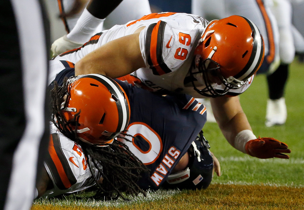 . Cleveland Browns defensive back Calvin Pryor (25) and Cleveland Browns defensive end Karter Schult (69) sack Chicago Bears quarterback Connor Shaw (9) for safety during the second half of an NFL preseason football game, Thursday, Aug. 31, 2017, in Chicago. (AP Photo/Nam Y. Huh)