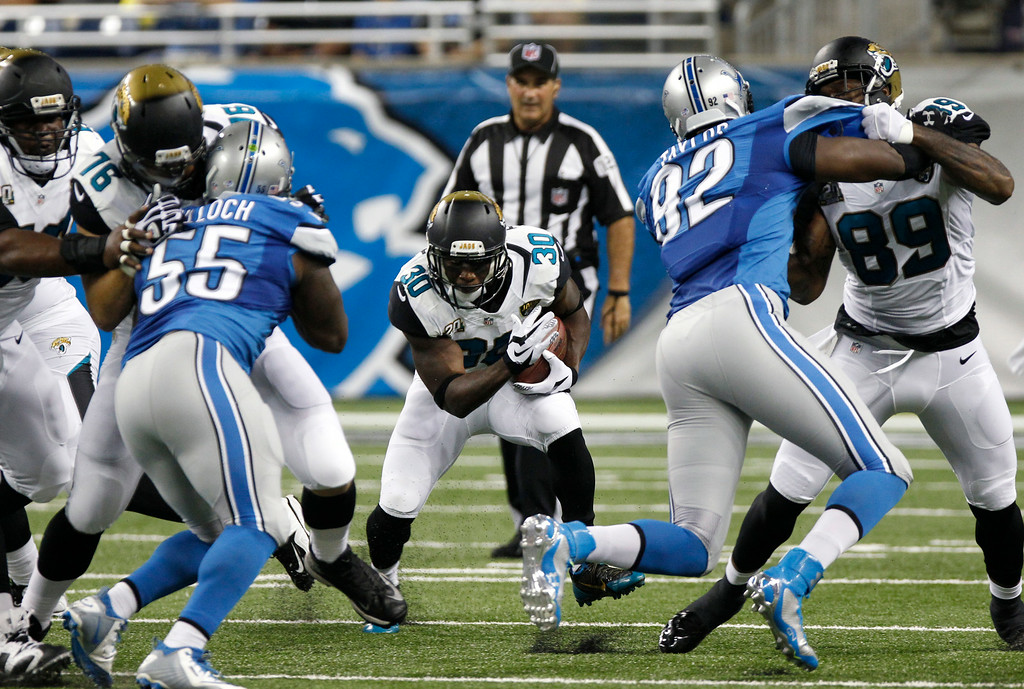 . Jacksonville Jaguars running back Jordan Todman (30) looks for running room against the Detroit Lions in the first half of a preseason NFL football game at Ford Field in Detroit, Friday, Aug. 22, 2014.  (AP Photo/Duane Burleson)