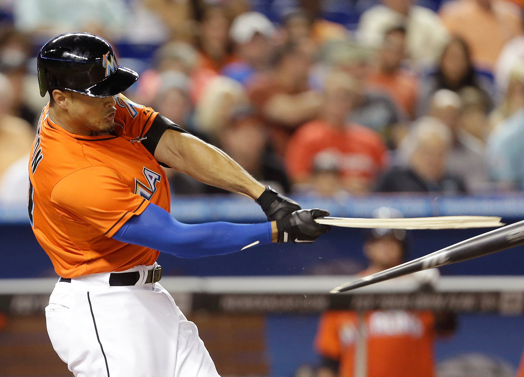 . Miami Marlins right fielder Giancarlo Stanton breaks his bat while batting during the fourth inning of an opening day baseball game, Monday, March 31, 2014, in Miami. (AP Photo/Lynne Sladky)