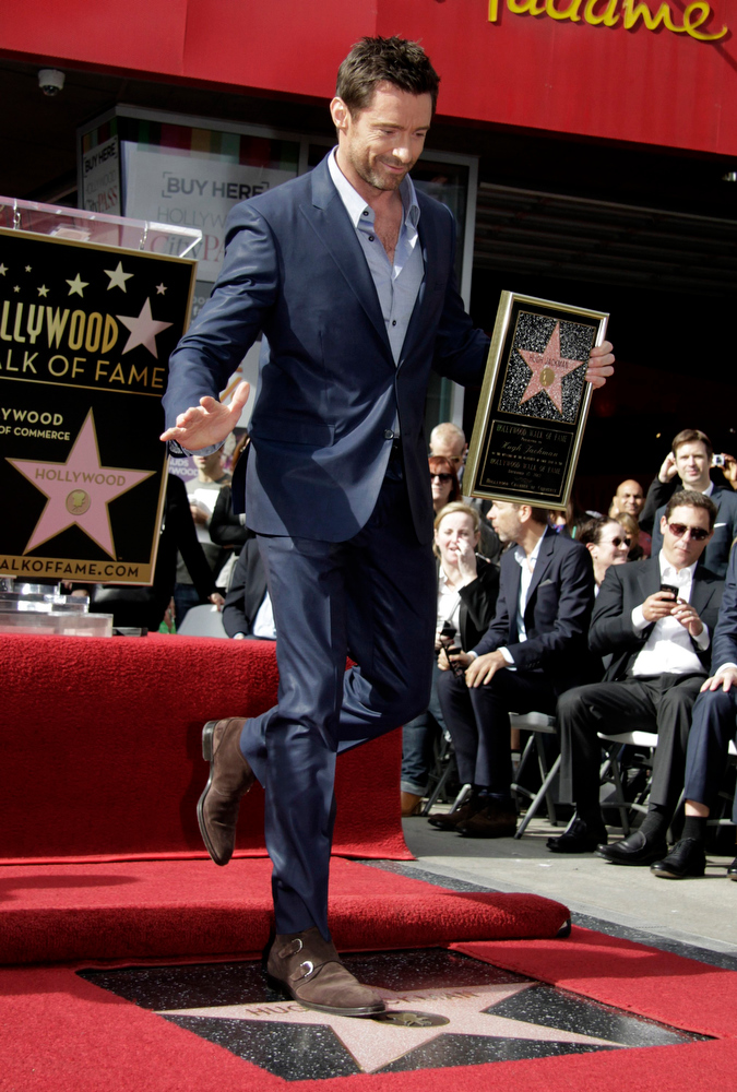 . Actor Hugh Jackman steps on his star during ceremonies honoring him with a star on the Hollywood Walk of Fame in Hollywood, California, December 13, 2012. REUTERS/Jonathan Alcorn