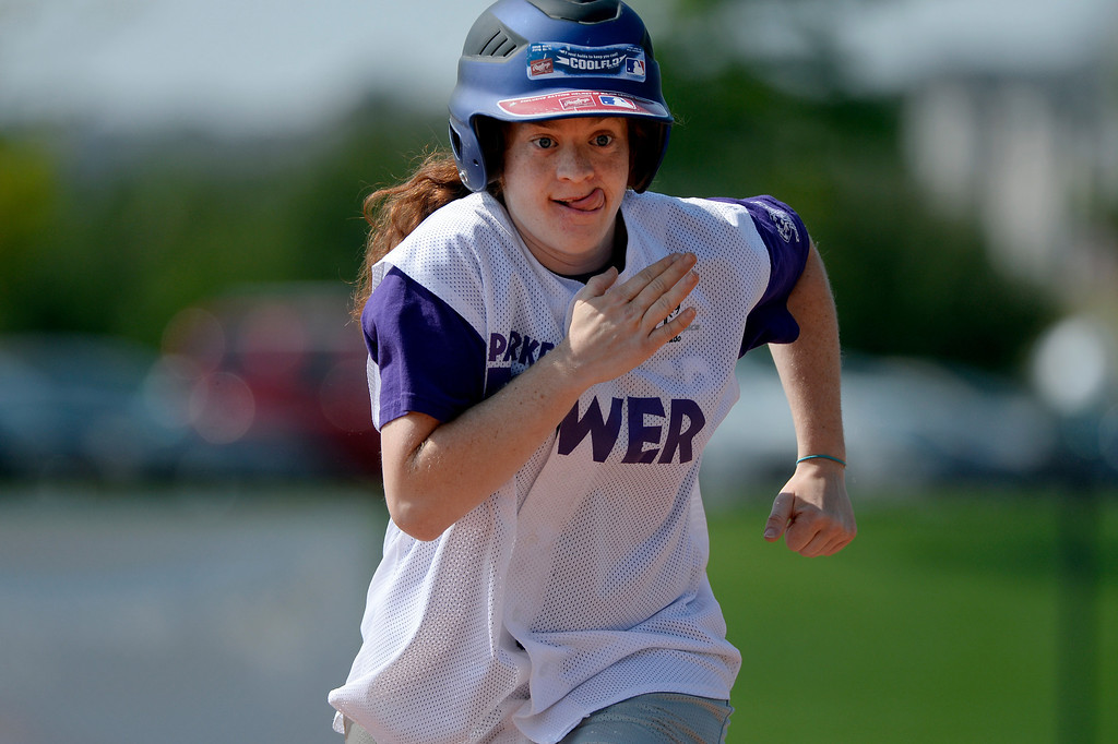 . DENVER, CO. - AUGUST 17: Candy Clarke, of the Parker Power, heads for third base during their softball game against the Colorado Springs Padres in the Special Olympics state championship at the Lowry Sports Complex in Denver, CO August 17, 2013. Special Olympics Colorado hosted its state championship in Bocce, Cycling, Golf, Softball and Tennis. Six hundred athletes competed in the events, which was supported by 250 volunteers and coaches. (Photo By Craig F. Walker / The Denver Post)