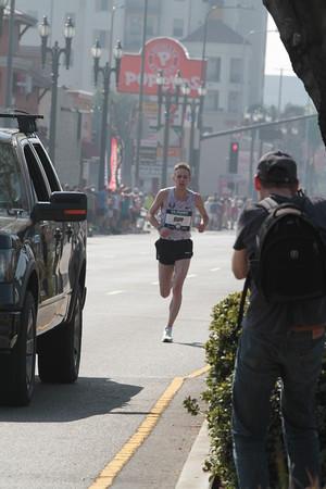 Men at 24.9 mile mark