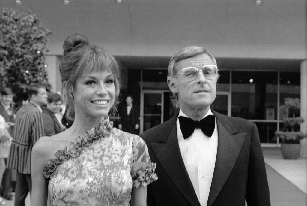. Arriving for the 25th Annual Emmy Awards telecast, May 20, 1973 at the Shubert Theater in Los Angeles are Mary Tyler Moore star of the ?Mary Tyler Moore show? and her husband a NBC Vice President, Grant Tinker. (AP Photo)