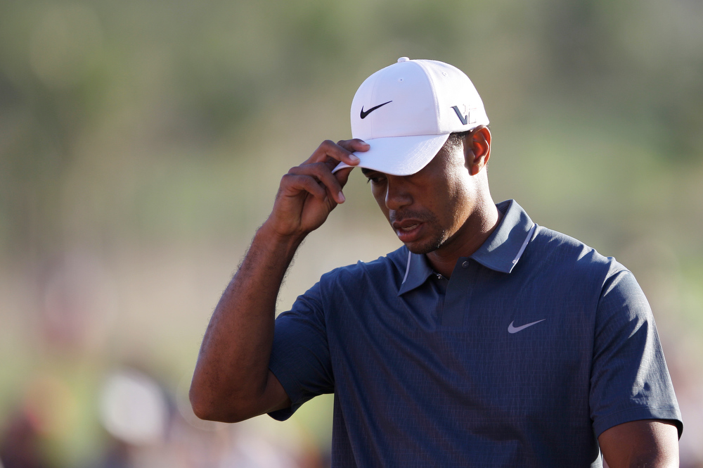 . Tiger Woods from the U.S. reacts to the fans after he finished the second round of Abu Dhabi Golf Championship in Abu Dhabi, United Arab Emirates, Friday, Jan. 18, 2013. (AP Photo/Kamran Jebreili)