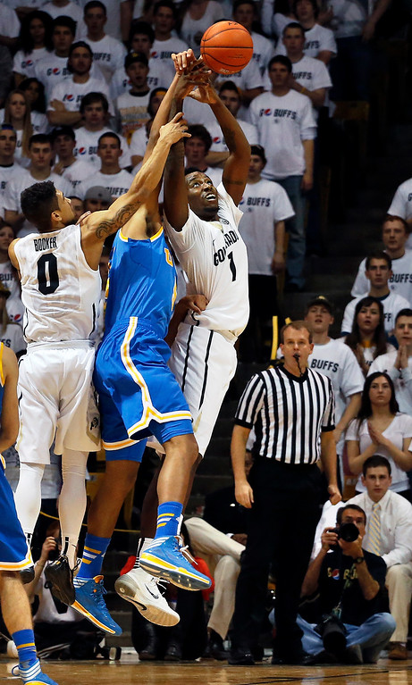 . Colorado\'s Askia Booker (0) and Wesley Gordon (1) struggle for the ball with UCLA\'s Kyle Anderson during the first half of an NCAA college basketball game in Boulder, Colo., Thursday, Jan. 16, 2014. (AP Photo/Brennan Linsley)