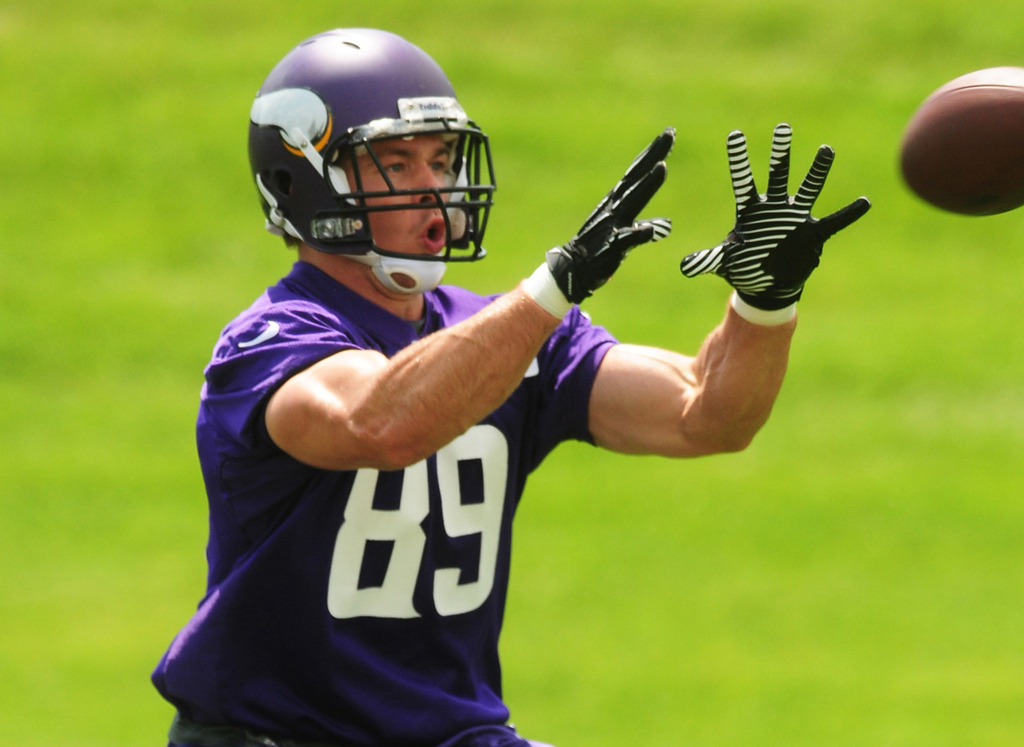 . Vikings tight end John Carlson grabs a pass during the team\'s minicamp on Tuesday. Carlson hopes to rebound after an injury sidelined him for most of the 2012 season.  (Pioneer Press: Scott Takushi)