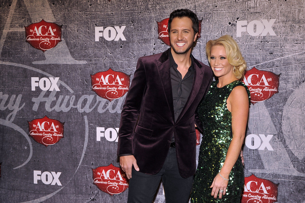 . From left, singer Luke Bryan and Caroline Boyer arrive at the American Country Awards on Monday, Dec. 10, 2012, in Las Vegas. (Photo by Jeff Bottari/Invision/AP)