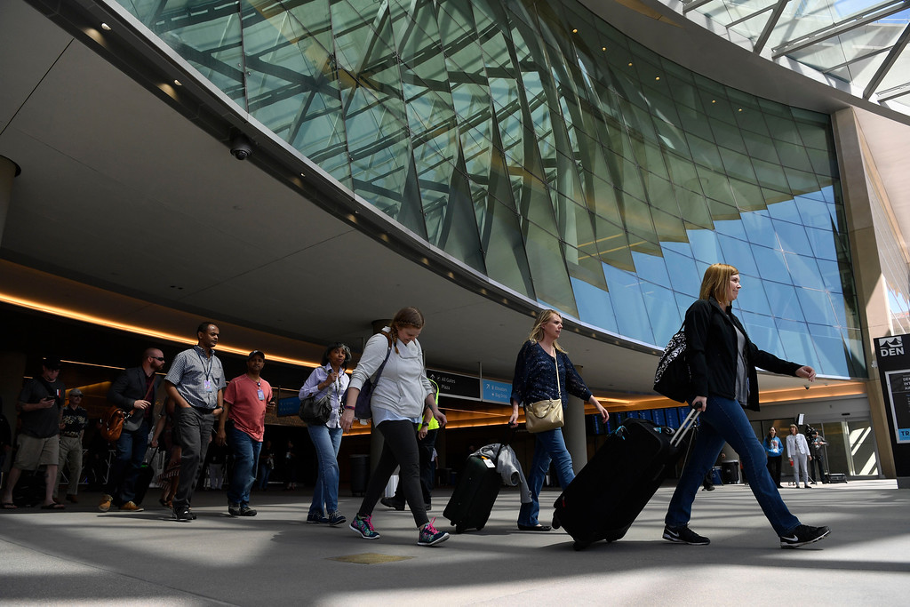 . Train passengers head to the platforms to take the RTD University of Colorado A-Line train at Denver International Airport April 22, 2016. (Photo by Andy Cross/The Denver Post)