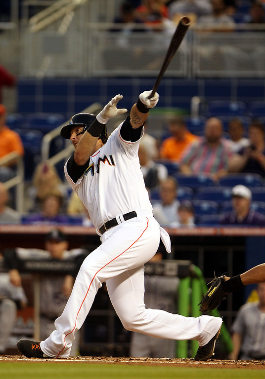 . Jarrod Saltalamacchia #39 of the Miami Marlins hits an RBI single against the Colorado Rockies during the third inning at the Marlins Park on April 1, 2014 in Miami, Florida.  (Photo by Marc Serota/Getty Images)