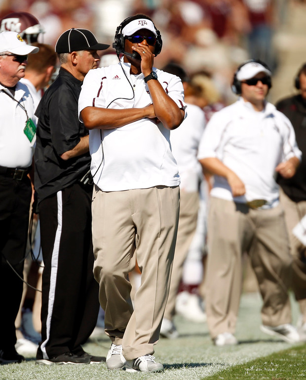 . Texas A&M head coach Kevin Sumlin walks the sidelines during the first half of an NCAA college football game against Vanderbilt, Saturday, Oct. 26, 2013, in College Station, Texas. (AP Photo/Eric Christian Smith)