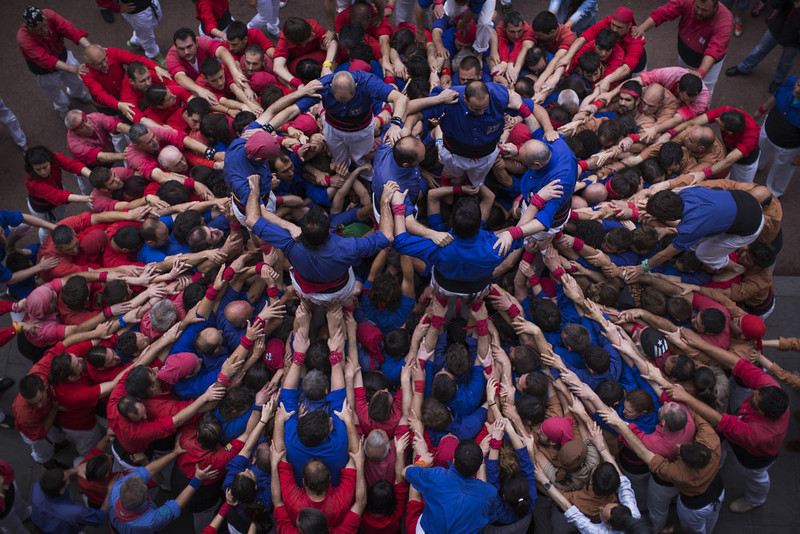 """. Members of the Castellers \""""Vila de Gracia\"""" start forming their famous human tower called \""""castell\"""" in the Barcelona neighborhood of Gracia, Catalonia, Spain on Sunday May 19 2013. A \""""castell\"""" is a human tower traditionally built during festivals in many places in Catalonia. At these festivals, several \""""colles\"""" or teams compete to build the most impressive towers they can. (AP Photo/Emilio Morenatti)"""