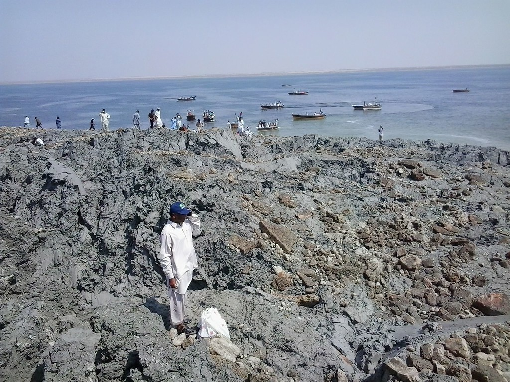 . This photograph taken on September 25, 2013, shows Pakistani residents as they gather on an island that appeared some two kilometres off the coastline of Gwadar after an earthquake. AFP PHOTO / Behram  BALOCH/AFP/Getty Images